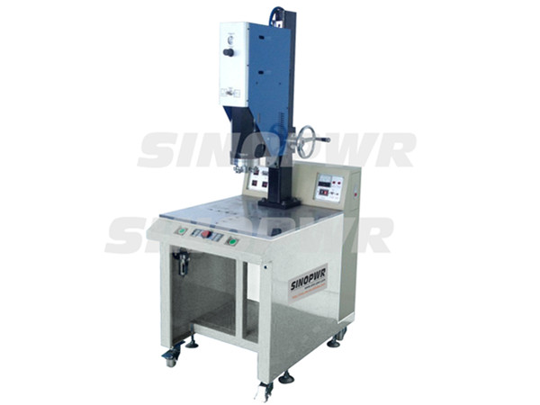 Integral ultrasonic plastic welding machine